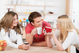 Housemates sharing coffee together