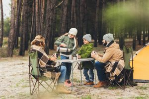 family eating outside on camping trip