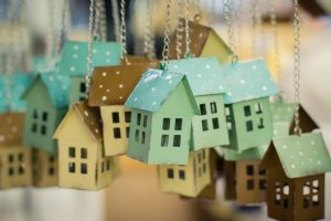 Colourful toy houses ornaments hanging on chains